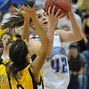 Broomfield's Renae Waters goes to the basket past Pueblo East's Alexa Snyder during Saturday's Great 8 4A game at the Colorado School of Mines Lockridge Arena.<br /> <br /> March 6, 2010<br /> Staff photo/David R. Jennings