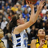 Broomfield's Renae Waters goes to the basket against Pueblo East during Saturday's Great 8 4A game at the Colorado School of Mines Lockridge Arena.<br /> <br /> March 6, 2010<br /> Staff photo/David R. Jennings