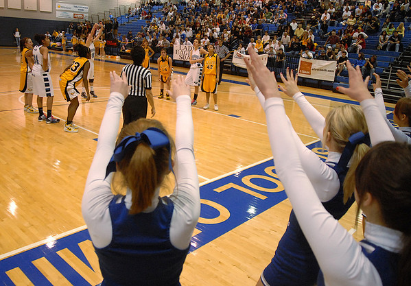 Broomfield cheerleaders give a silent cheer duirng a free throw shot against Pueblo East's xxx during Saturday's Great 8 4A game at the Colorado School of Mines Lockridge Arena.<br /> <br /> March 6, 2010<br /> Staff photo/David R. Jennings