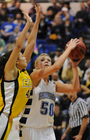 Broomfield's Bre Burgesser goes to the basket against Pueblo East's Chelby Santiago during Saturday's Great 8 4A game at the Colorado School of Mines Lockridge Arena.<br /> <br /> March 6, 2010<br /> Staff photo/David R. Jennings