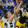 Broomfield's Renae Waters goes to the basket against Pueblo East's Tracey Versteeg during Saturday's Great 8 4A game at the Colorado School of Mines Lockridge Arena.<br /> <br /> March 6, 2010<br /> Staff photo/David R. Jennings