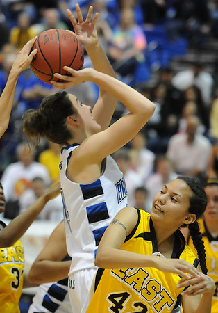 Broomfield's Katie Nehf has the ball knocked away while colliding with  Pueblo East's Caroline Marrero during Saturday's Great 8 4A game at the Colorado School of Mines Lockridge Arena.<br /> <br /> March 6, 2010<br /> Staff photo/David R. Jennings