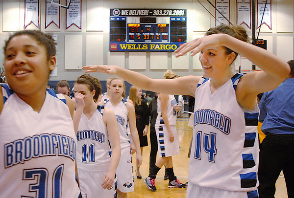 Broomfield's Katie Nehf, right , cheers after the Eagles defeated Pueblo East in Saturday's Great 8 4A game at the Colorado School of Mines Lockridge Arena.<br /> <br /> March 6, 2010<br /> Staff photo/David R. Jennings