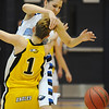Broomfield's Katie Nehf collides with Pueblo East's Holly Carter during Saturday's Great 8 4A game at the Colorado School of Mines Lockridge Arena.<br /> <br /> March 6, 2010<br /> Staff photo/David R. Jennings