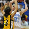 Broomfield's Sarah Hix goes to the basket against Pueblo East's Jackie Glover during Saturday's Great 8 4A game at the Colorado School of Mines Lockridge Arena.<br /> <br /> March 6, 2010<br /> Staff photo/David R. Jennings