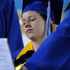 Megan Brunson plays the piano and sings during the Broomfield High graduation at Elizabeth Kennedy Stadium on Saturday.<br /> May 22, 2010<br /> Staff photo/ David R. Jennings
