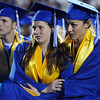 Megan Brunson, left, and Amanda Ardito try to keep each other warm during the Broomfield High graduation Saturday night at Elizabeth Kennedy Stadium.<br /> May 22, 2010<br /> Staff photo/ David R. Jennings