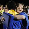 Tara Lundquist hugs Darius Nazemi after Saturday night's Broomfield High graduation at Elizabeth Kennedy Stadium.<br /> May 22, 2010<br /> Staff photo/ David R. Jennings