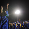 Gymnast JoJo Hayden raises her arms after completing a back flip off of the stage after receiving her diploma at Saturday's  Broomfield High graduation at Elizabeth Kennedy Stadium.<br /> May 22, 2010<br /> Staff photo/ David R. Jennings