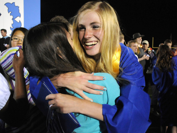 Margaret Vogt hugs a friend after Broomfield High graduation at Elizabeth Kennedy Stadium on Saturday.<br /> May 22, 2010<br /> Staff photo/ David R. Jennings