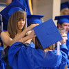 Kayla Albo helps a fellow graduate with her cap before the Broomfield High graduation at Elizabeth Kennedy Stadium on Saturday.<br /> May 22, 2010<br /> Staff photo/ David R. Jennings