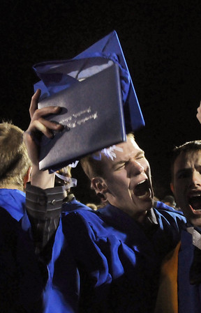 Trent Cline gives a cheer while celebrating both graduating and his birthday at the Broomfield High graduation at Elizabeth Kennedy Stadium on Saturday.<br /> May 22, 2010<br /> Staff photo/ David R. Jennings