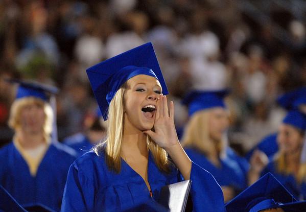 Karissa Frakes cheers on fellow graduates receiving their diplomas  during the Broomfield High graduation at Elizabeth Kennedy Stadium on Saturday.<br /> May 22, 2010<br /> Staff photo/ David R. Jennings