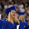 Karissa Frakes cheers on fellow graduates receiving their diplomas  during the Broomfield High graduation at Elizabeth Kennedy Stadium on Saturday.<br /> May 22, 2010<br /> Staff photo/ David R. Jennings