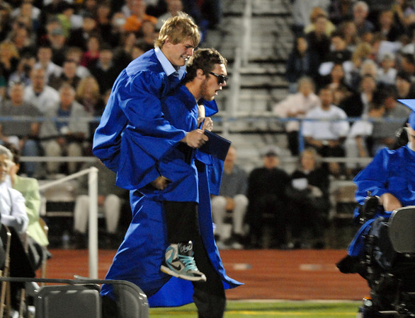 The last two graduates David Techmanski is carried by fellow graduate Kyle Megna during Saturday's Broomfield High graduation at Elizabeth Kennedy Stadium.<br /> May 22, 2010<br /> Staff photo/ David R. Jennings