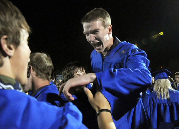 Trent Cline celebrates both graduating and his birthday at the Broomfield High graduation at Elizabeth Kennedy Stadium on Saturday.<br /> May 22, 2010<br /> Staff photo/ David R. Jennings