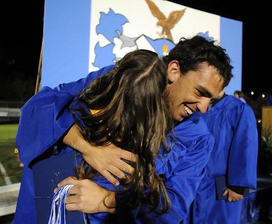 Gabe Ricket hugs Melanie Ferraro after Broomfield High's night time  graduation at Elizabeth Kennedy Stadium on Saturday.<br /> May 22, 2010<br /> Staff photo/ David R. Jennings