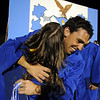 Gabe Ricket hugs Melanie Ferraro after Broomfield High's night time  graduation at Elizabeth Kennedy Stadium on Saturday.<br /> May 22, 2010<br /> Staff photo/ David R. Jennings