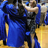 Bre Mathews, right, helps Tiana Rendon with her cap before the Broomfield High graduation at Elizabeth Kennedy Stadium on Saturday.<br /> May 22, 2010<br /> Staff photo/ David R. Jennings