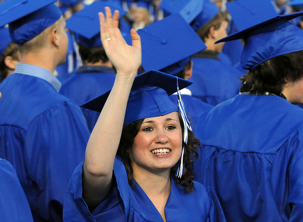 Stephanie Babcock waves at her family during the Broomfield High graduation at Elizabeth Kennedy Stadium on Saturday.<br /> May 22, 2010<br /> Staff photo/ David R. Jennings