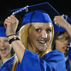 Michelle Stovall turns her braided tassel during Saturday night's Broomfield High graduation at Elizabeth Kennedy Stadium.<br /> May 22, 2010<br /> Staff photo/ David R. Jennings
