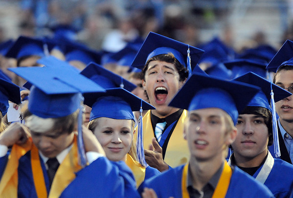 A graduate yells out a cheer during the Broomfield High graduation at Elizabeth Kennedy Stadium on Saturday.<br /> May 22, 2010<br /> Staff photo/ David R. Jennings