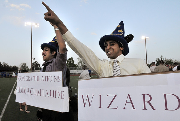 Neil Patel, left and his cousin Sunny Patel, wearing blinking wizard hats, cheer on Sunny's graduating brother Neil Patel before Saturday night's  Broomfield High graduation at Elizabeth Kennedy Stadium.<br /> May 22, 2010<br /> Staff photo/ David R. Jennings