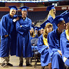 Zachary Doyle, left, and Warren Eckman pose briefly in the aisle while walking to receive their diplomas during Saturday's Broomfield High School Commencement at the 1stBank Center.<br /> <br /> May 19, 2012 <br /> staff photo/ David R. Jennings