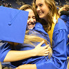 Rachel Kois, center, hugs Rachel Mostek, right, and  Samantha Bartle after Saturday's Broomfield High School Commencement at the 1stBank Center.<br /> <br /> May 19, 2012 <br /> staff photo/ David R. Jennings