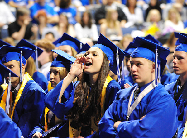 Katalena Laufasa-Duncan cheers for fellow graduates during Saturday's Broomfield High School Commencement at the 1stBank Center.<br /> <br /> May 19, 2012 <br /> staff photo/ David R. Jennings
