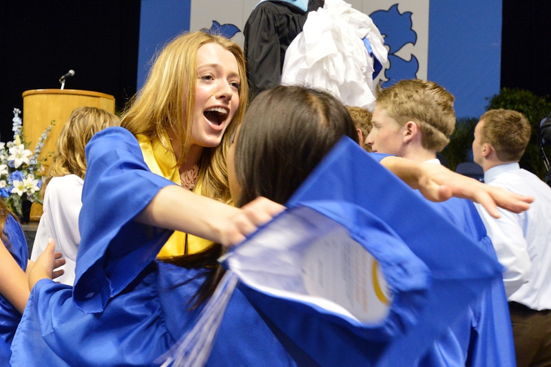 Kathryn Middel-Katzenmeyer reachs out to hug Mai Yang after Saturday's Broomfield High School Commencement at the 1stBank Center.<br /> <br /> May 19, 2012 <br /> staff photo/ David R. Jennings
