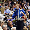 Student usher Ethan Reed hands out roses to parents and gardians for the Tradition of the Roses during Saturday's Broomfield High School Commencement at the 1stBank Center.<br /> <br /> May 19, 2012 <br /> staff photo/ David R. Jennings