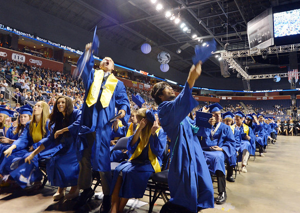 Nick Reisch, left and Leon Mireles lead the tossing of the caps into the air at the end of Saturday's Broomfield High School Commencement at the 1stBank Center.<br /> <br /> May 19, 2012 <br /> staff photo/ David R. Jennings