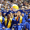 Graduates bounced beach balls during Saturday's Broomfield High School Commencement at the 1stBank Center.<br /> <br /> May 19, 2012 <br /> staff photo/ David R. Jennings