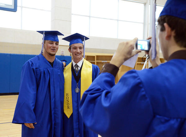 Jimmy Roberts, left, and Jack Reece have their pictures taken by Ryan Davis before Saturday's Broomfield High School Commencement at the 1stBank Center.<br /> <br /> May 19, 2012 <br /> staff photo/ David R. Jennings