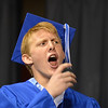 Devon Beta gives a cheer to a fellow graduate while waiting in line to receive his diploma during Saturday's Broomfield High School Commencement at the 1stBank Center.<br /> <br /> May 19, 2012 <br /> staff photo/ David R. Jennings