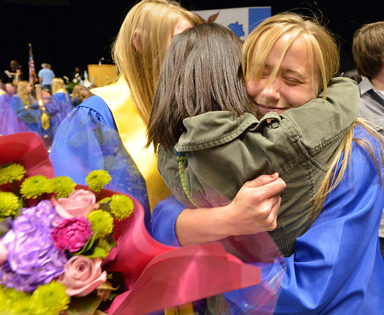 Kayley Thompson hugs Grace Peketz after Saturday's Broomfield High School Commencement at the 1stBank Center.<br /> <br /> May 19, 2012 <br /> staff photo/ David R. Jennings