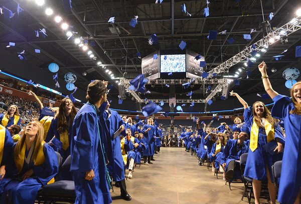 Graduates toss their caps in the air after Saturday's Broomfield High School Commencement at the 1stBank Center.<br /> <br /> May 19, 2012 <br /> staff photo/ David R. Jennings