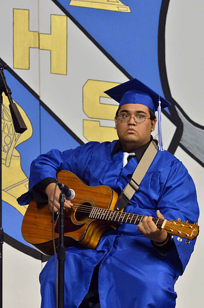 Nathan Hastings plays the guitar during Saturday's Broomfield High School Commencement at the 1stBank Center.<br /> <br /> May 19, 2012 <br /> staff photo/ David R. Jennings