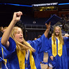 Kayley Thompson raises her diploma after Saturday's Broomfield High School Commencement at the 1stBank Center.<br /> <br /> May 19, 2012 <br /> staff photo/ David R. Jennings