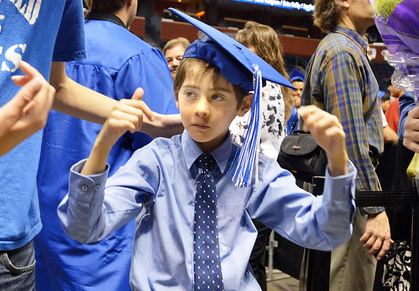 Jeremy Mena, 8, tries on his sister, Claire's, cap after Saturday's Broomfield High School Commencement at the 1stBank Center.<br /> <br /> May 19, 2012 <br /> staff photo/ David R. Jennings