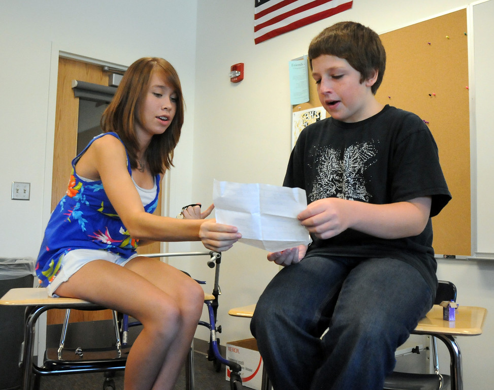 Broomfield High School freshmen Nicola Cave, left, and Jonny Schmitt  chat to find out more about each other during Tuesday's freshman transition day.<br /> August 17, 2010<br /> staff photo/David R. Jennings