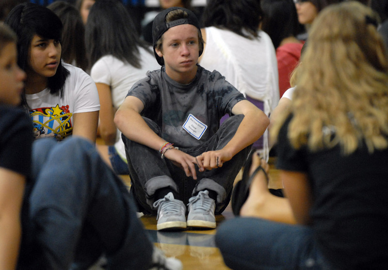 Chase Wainwright, center, Broomfield High School freshman, listens to his Blue Crew leader before going to classrooms during Tuesday's freshman transition day.<br /> August 17, 2010<br /> staff photo/David R. Jennings