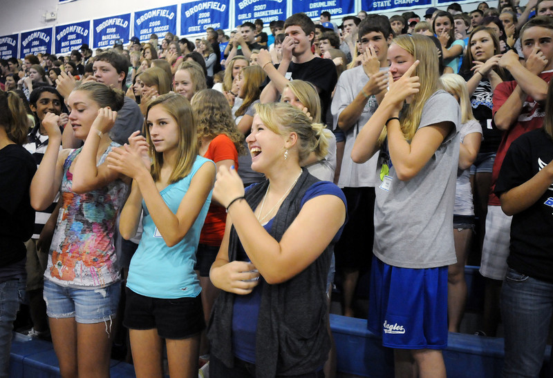 Broomfield High School freshman Paige Lindbloom, center, laughs while trying to jester to a song with fellow classmates during a team building exercise at Tuesday's freshman transition day.<br /> August 17, 2010<br /> staff photo/David R. Jennings