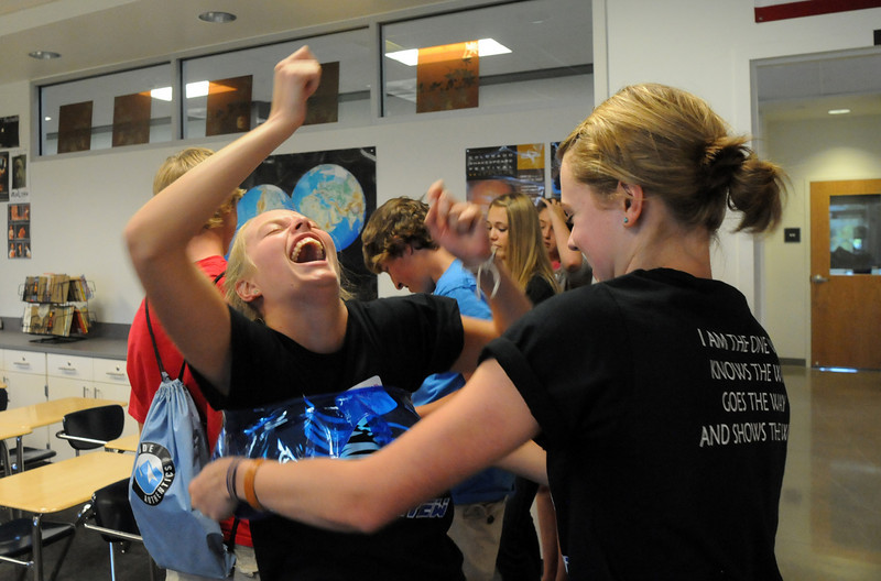 Broomfield High School Blue Crew leader Madison Goering, left, laughs as fellow leader Kathryn Middle-Katzenmeyer, right, helps her  into the scuba/snorkling costume before taking the freshmen on a tour of the school during Tuesday's freshman transition day.<br /> August 17, 2010<br /> staff photo/David R. Jennings