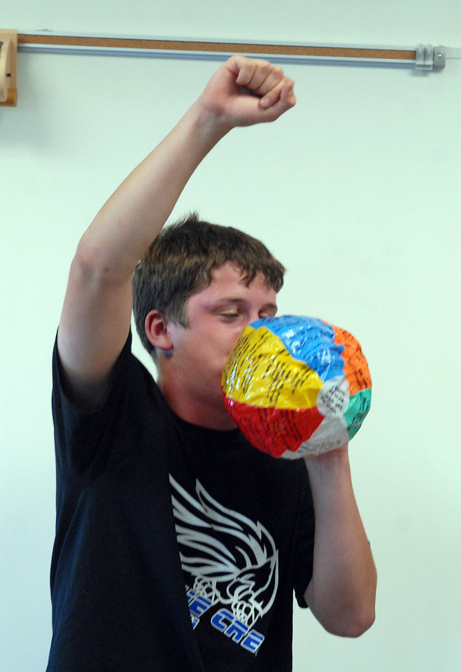 Broomfield High School Blue Crew leader Alex Brisnehan blows up a beach ball that has questions for freshmen in his group to answer during Tuesday's freshman transition day.<br /> August 17, 2010<br /> staff photo/David R. Jennings