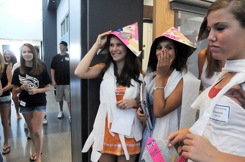 Broomfield High School freshmen Amy Anderson, left, Kyla Killman and Elizabeth Lukins, wearing hats from their Blue Crew leaders, prepare to take a tour of the school during Tuesday's freshman transition day.<br /> August 17, 2010<br /> staff photo/David R. Jennings