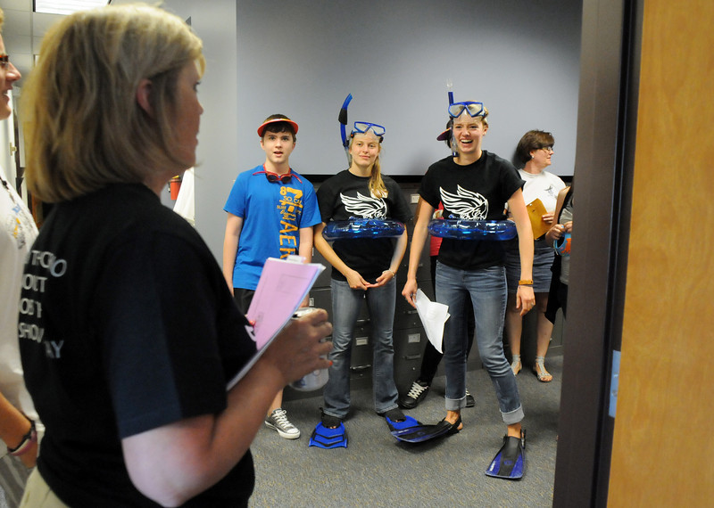 Broomfield High School principal Ginger Ramsey. left, greets freshmen and their Blue Crew leaders while on a tour of the school during Tuesday's freshman transition day.<br /> August 17, 2010<br /> staff photo/David R. Jennings