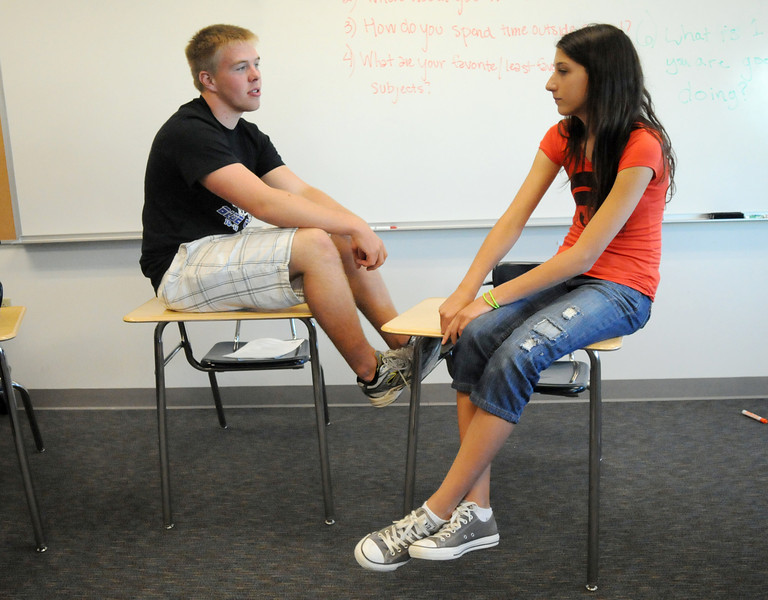 Broomfield High School Blue Crew leader Nick Martella, left, answers questions from freshman Monro Obenaver during Tuesday's freshman transition day.<br /> August 17, 2010<br /> staff photo/David R. Jennings