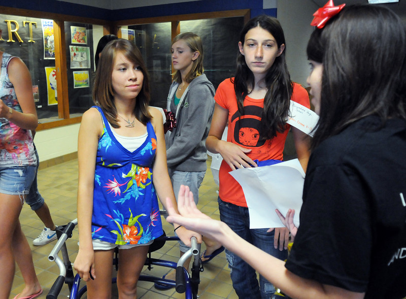 Broomfield High School Blue Crew leader Becca Looney, right, answers questions from freshmen Nicola Cave, left, and Monro Obenaver while on a tour of the school during Tuesday's freshman transition day.<br /> August 17, 2010<br /> staff photo/David R. Jennings